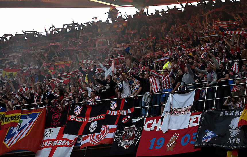 Atletico Madrid fans in action during todays match  <br /> <br /> Photographer Ian Cook/CameraSport<br /> <br /> Football - UEFA Champions League Final 2014 - Real Madrid v Atletico Madrid - Saturday 24th May 2014 - Stadium of Light - Lisbon - Portugal<br /> <br /> &copy; CameraSport - 43 Linden Ave. Countesthorpe. Leicester. England. LE8 5PG - Tel: +44 (0) 116 277 4147 - admin@camerasport.com - www.camerasport.com