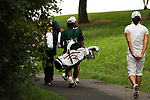 Seo-Jae Lee walks slowly on the 18th tee during Alliance Bank Golf Classic in Syracuse, NY.