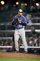 West Michigan Whitecaps relief pitcher Oswaldo Castillo (22) gets ready to deliver a pitch during a game against the Fort Wayne TinCaps on May 17, 2018 at Parkview Field in Fort Wayne, Indiana.  Fort Wayne defeated West Michigan 7-3.  (Mike Janes/Four Seam Images)