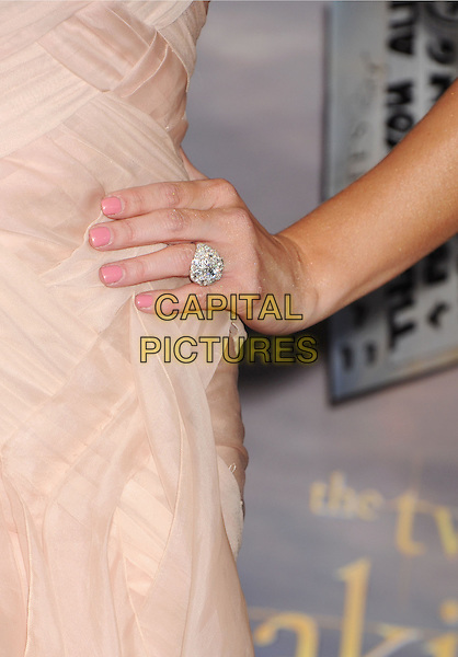 "Ashley Greene's hand.""The Twilight Saga: Breaking Dawn - Part 2"" Los Angeles Premiere held at Nokia Theatre L.A. Live, Los Angeles, California, USA..November 12th, 2012.on hip detail nail varnish polish diamond ring jewellery jewelry pink sheer .CAP/ROT/TM.©Tony Michaels/Roth Stock/Capital Pictures"