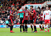 3rd December 2017, Vitality Stadium, Bournemouth, England; EPL Premier League football, Bournemouth versus Southampton; Referee Jonathan Moss is confronted by Jermain Defoe of Bournemouth after Andrew Surman of Bournemouth is brought down in the area