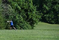 NWA Democrat-Gazette/J.T. WAMPLER  Barryjoe Rogers winds up for a drive Tuesday June 5, 2018 at J. Beast Disc Golf Course at J.B. Hunt Park in Springdale.