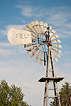 Waxing moon over old back-gear 1920s IXL metal windmill on display in a park in Washtucna, Wash.