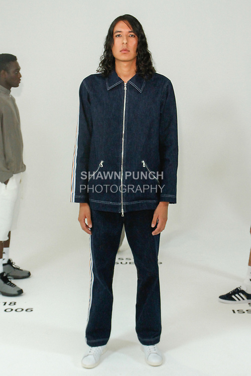 Model poses in an outfit from the Bristol Spring Summer 2018 collection by Luke Tadashi and Tommy Nowels, for New York Mens Day at Dune Studios on July 10, 2017; duing New York Fashion Week: Mens Spring Summer 2018.