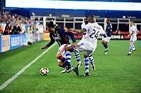 September 9, 2017 - Foxborough, Mass:New England Revolution midfielder Lee Nguyen (24) (blue) gets tripped by Montreal Impact forward Anthony Jackson-Hamel (24) (white)  during the MLS game between the Montreal Impact and the New England Revolution held at Gillette Stadium in Foxborough Massachusetts. Revolution defeat Impact 1-0. Eric Canha/CSM