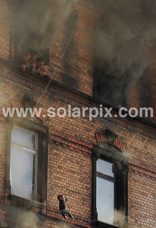 **ALL ROUND PICTURES FROM SOLARPIX.COM**.**SYNDICATION RIGHTS FOR UK AND SPAIN ONLY**.**NO PUBLICATION IN DAILY NEWSPAPERS, HARD COPY OR ONLINE**.A fire in an apartment in the German city of Ludwigshafen on February 3rd, 2008. Nine people died, and because of the wooden construction of the staircase residents were not able to escape. Parents had to throw out their children to save their life before jumping out themselves. Police are investigating whether the fire was racially motivated arson against the mainly Turkish community residing there...This pic: Ludwigshafen fire baby..JOB REF: 5705 CPR        DATE: 03_02_2008.**MUST CREDIT SOLARPIX.COM OR DOUBLE FEE WILL BE CHARGED* *UNDER NO CIRCUMSTANCES IS THIS IMAGE TO BE REPRODUCED FOR ANY ONLINE EDITION WITHOUT PRIOR PERMISSION*
