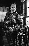 "December 1971:  Modesto, California—Dad Walkling— Gets his canes ready for sale.  I first met Orlando ""Dad"" Walkling at his house in the airport district of Modesto just before his 104th birthday.  Walkling was born in Indian Territory January 2, 1868, near a town now called McAlester, Oklahoma.  His mother was Shawnee and his father, whom he didn't remember, was an Englishman named Orlando.  He later used the name Walkling instead of his Indian name of Skipocase.  On September 16, 1893, Skipocase O. Walkling, then 25 years old, was among thousands of settlers who rode into the Cherokee Strip Land Run of Oklahoma to make a free land claim.  Walkling told of how he rode into the 226-mile long ""Strip"" to claim 160 acres.  ""There were thousands of men who waited at the line until noon that day.  The army gun was fired and chaos broke out. Every man carried a gun. There was no law, no sheriff, nothing.  People had to fight for their claim even though they were first.""  Walkling made a claim, but later gave it up when he had a chance to farm a piece of land in Noble County, Oklahoma.  He cleared the land with six yoke of oxen and planted peach orchards.  He and his first wife ran a combination grocery store and hotel there.  He had nearly 1,000 trees and began a cannery to process the crops.  ""One day when the train came in a woman dressed like a Salvation Army woman handed me a bundle as I stood on the ramp, then she jumped back into the train.  I opened it and there was a pair of twins, a boy and a girl,"" Walkling said.  He and his wife did not have children, so they adopted the twins legally and raised them.  He said they raised six others but did not adopt them.  He came to Modesto in 1944 at 76 years of age and went to work for a meat firm before he opened a poultry store.  After that store closed, he made bullwhips and wove rope for truckers at his home.  In 1968, Dad Walking, then 100 years old, visited Oklahoma for the 75th anniversary of the Running of"