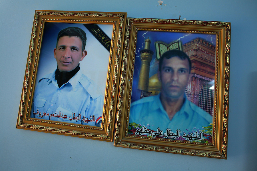 Photographs of Iraqi policemen slain by insurgents and militiamen hang in the entryway of a police station in the Adhamiya district of Baghdad on Thursday April 27, 2007.