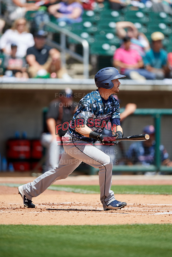 Jacksonville Jumbo Shrimp catcher Cam Maron (7) follows through on a swing during a game against the Birmingham Barons on April 24, 2017 at Regions Field in Birmingham, Alabama.  Jacksonville defeated Birmingham 4-1.  (Mike Janes/Four Seam Images)