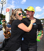 Sep 5, 2016; Clermont, IN, USA; NHRA pro stock driver Chris McGaha celebrates with wife Holly McGaha after winning the US Nationals at Lucas Oil Raceway. Mandatory Credit: Mark J. Rebilas-USA TODAY Sports