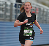 Jacqueline Amato, 12, of East Quogue becomes the first female finisher to complete the 2016 Long Island Marathon Weekend's 1 mile race inside Mitchel Athletic Complex on Saturday, Apr. 30, 2016.