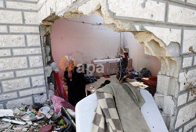 "Palestinians search in their destroyed house in Khan Yunis in the southern Gaza Strip on September 11, 2014. Israel's deputy foreign minister,Tzahi Hanegbi , warned that Hamas was likely to resume ""violence"" if it feels it has made no political gains from upcoming talks in Cairo. Photo by Abed Rahim Khatib"