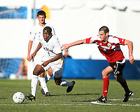 Darlington Naqbe #6 of the University of Akron heads away from Paolo DelPiccolo #3 of the University of Louisville during the 2010 College Cup final at Harder Stadium, on December 12 2010, in Santa Barbara, California.Akron champions, 1-0.