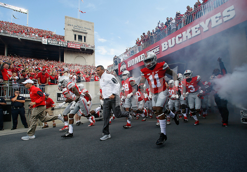 Ohio State Buckeyes head coach Urban Meyer  leads his team onto the field for the first quarter of the NCAA football game at Ohio Stadium in Columbus on Sept. 12, 2015. (Adam Cairns / The Columbus Dispatch)