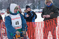 Musher # 48 Wade Marrs at the Restart of the 2009 Iditarod in Willow Alaska