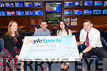 Far Left:  Shirley Kilmartin (Boylesports Regiona Manager) and Far Right Alan O'Brien BoyleSports Manager of Park Road Branch in Killarney) presented a cheque for €2500 to Aishling Duggan and Jason McElligott from Lisowel in the BoyleSports, Park Road Killarney last Saturday.