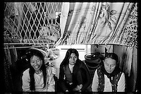 Vietnamese refugee women and a young boy wait at a boat people camp in Hong Kong. Tens of thousands of Vietnamese refugees fled the Communist regime by boats to Hong Kong in 1980s.