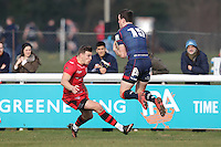 Peter Lydon of London Scottish (right) collects the ball during the Greene King IPA Championship match between London Scottish Football Club and Jersey at Richmond Athletic Ground, Richmond, United Kingdom on 18 February 2017. Photo by David Horn / PRiME Media Images.