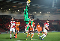 Doncaster Rovers' Ian Lawlor saves an attempt at goal by Blackpool's Joe Dodoo<br /> <br /> Photographer Rachel Holborn/CameraSport<br /> <br /> The EFL Sky Bet League One - Doncaster Rovers v Blackpool - Tuesday 27th November 2018 - Keepmoat Stadium - Doncaster<br /> <br /> World Copyright &copy; 2018 CameraSport. All rights reserved. 43 Linden Ave. Countesthorpe. Leicester. England. LE8 5PG - Tel: +44 (0) 116 277 4147 - admin@camerasport.com - www.camerasport.com
