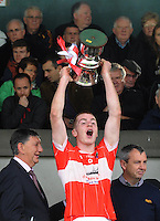 26-10-2014:  Dingle  captain Barry O'Sullivan raises the cup aloft after winning  the Kerry minor football County Championship final at Austin Stack Park, Tralee on Sunday.  Picture: Eamonn Keogh ( MacMonagle, Killarney)