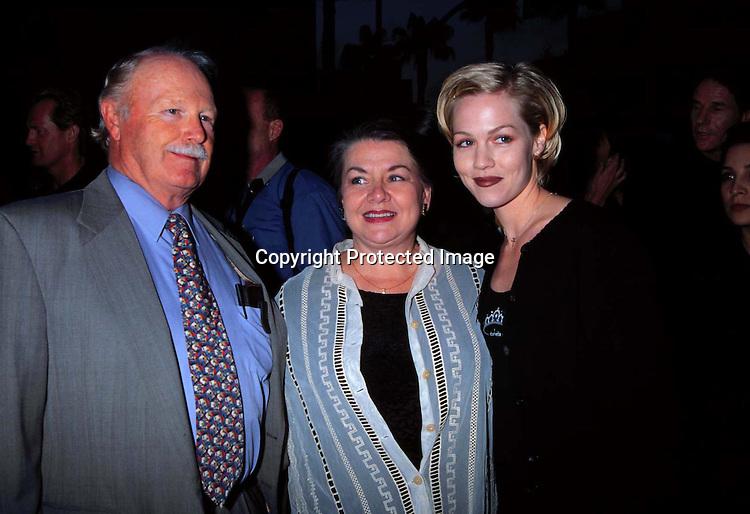 """©KATHY HUTCHINS/HUTCHINS PHOTO.4/30/98 """" DANCER ,TX POP 81 """" PREMIERE.JENNIE GARTH & HER PARENTS"""