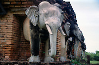 Wat Chang Lom (Elephant Monument) - Built in the late 14th Century, the main Bell shaped Chedi of Wat Chang Lom is surrounded by 32 elephant sculptures placed in a position so that they appear to be holding up the entire structure. Si Satchanalai Historical Park -  Sukhothai, Thailand.