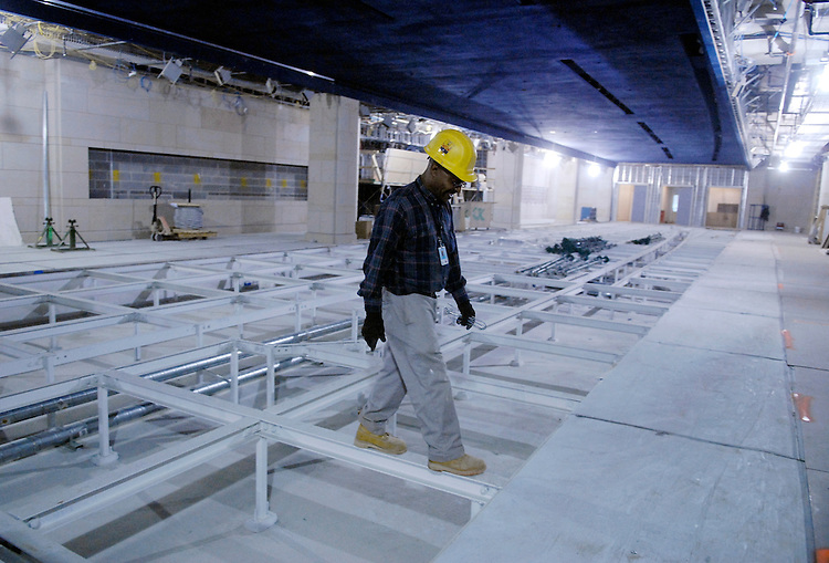 Dave Turner walks across frames that will support a glass floor, on the site of the Capitol Visitor Center.