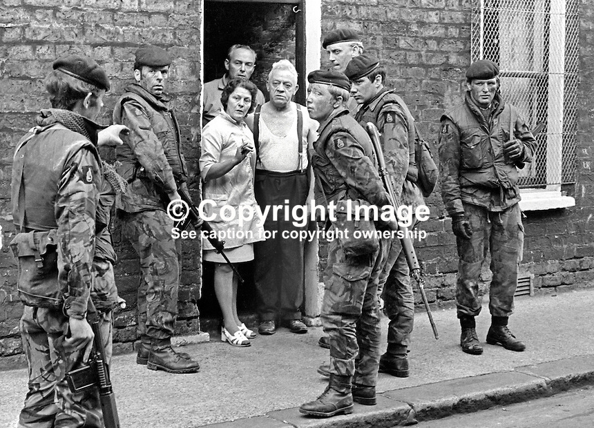 British soldiers quiz local residents in a follow-up arms search in the Markets area of Belfast, N Ireland, after an all-night gun battle. The upsurge in violence was triggered by the introduction of internment.197108090384a.<br />