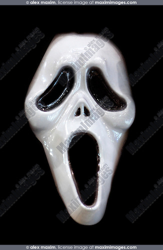 Scary white face isolated on black background. Conceptual Halloween photo-illustration.
