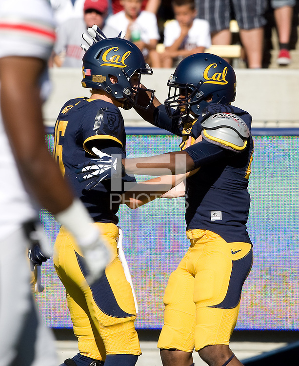 James Grisom of California celebrates with Jared Goff after scoring a touchdown during the game against Ohio State at Memorial Stadium in Berkeley, California on September 14th, 2013.  Ohio State defeated California, 52-34.