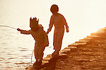 Children playing at water's edge