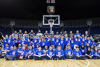 16.01.2013 London, England. Youngsters pose on court with basketball stars as part of NBA Cares outreach programme ahead of the NBA London Live 2013 game between the Detroit Pistons and the New York Knicks from The O2 Arena