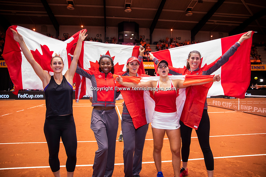 Den Bosch, The Netherlands, Februari 10, 2019,  Maaspoort , FedCup  Netherlands - Canada, first match Sunday : Canadian tean celebrate ltr: Gabriella Dabrowski, Francoise Abanda, captain Heidi El Tabakh, Bianca Andreescu and  Rebecca Marino.<br /> Photo: Tennisimages/Henk Koster