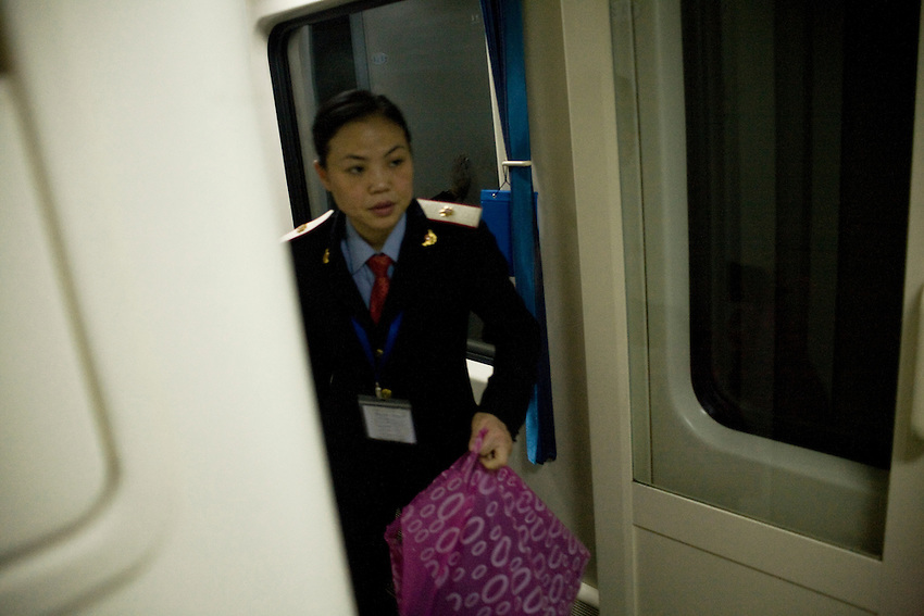 Train officer is cleaning the wagon in the night-train from Guangzhou to Beijing.
