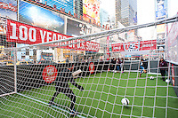 Fans take shots on goal during the centennial celebration of U. S. Soccer at Times Square in New York, NY, on April 04, 2013.