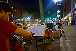 A string quartet of University of Michigan School of Music students perform orchestral covers of Lady Gaga and other pop favorites for strolling patrons along Main Street's restaurants and shops, Friday, Sept. 2, 2011 in Ann Arbor, Mich. (Tony Ding for The New York Times)