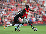 Manchester United's Paul Pogba tussles with West Ham's Edmilson Fernandes during the premier league match at Old Trafford Stadium, Manchester. Picture date 13th August 2017. Picture credit should read: David Klein/Sportimage