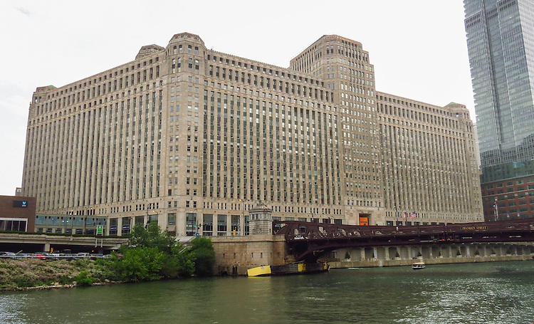Chicago's Merchandise Mart, as seen on the Chicago Architecture Foundation's river cruise. When it opened in 1930 it was the largest building in the world, with 4,000,000 square feet of floor space. Built by Marshall Field & Co. and later owned for over half a century by the Kennedy family, the Mart centralized Chicago's wholesale goods business by consolidating architectural and interior design vendors and trades under a single roof. (DePaul University/Jamie Moncrief)