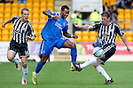 St Johnstone v St Mirren...11.09.10  .Jennison Myrie-Williams skips between Jure Travner and Sean Lynch.Picture by Graeme Hart..Copyright Perthshire Picture Agency.Tel: 01738 623350  Mobile: 07990 594431