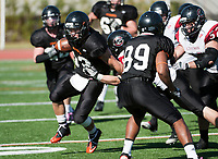 The Occidental College football team plays against Chapman University during Homecoming weekend on Saturday, October 29, 2011 on Patterson Field in Kemp Stadium. Oxy wins. (Photo by Marc Campos, Occidental College Photographer)