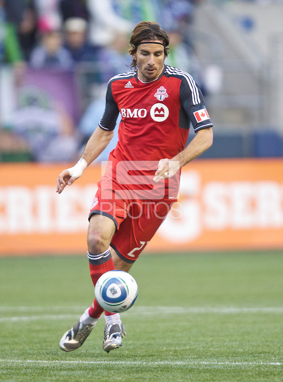 Toronto FC forward Alan Gordon takes the ball up field during play against the Seattle Sounders FC at Qwest Field in Seattle Saturday April 30, 2011. The Sounders won the game 3-0.