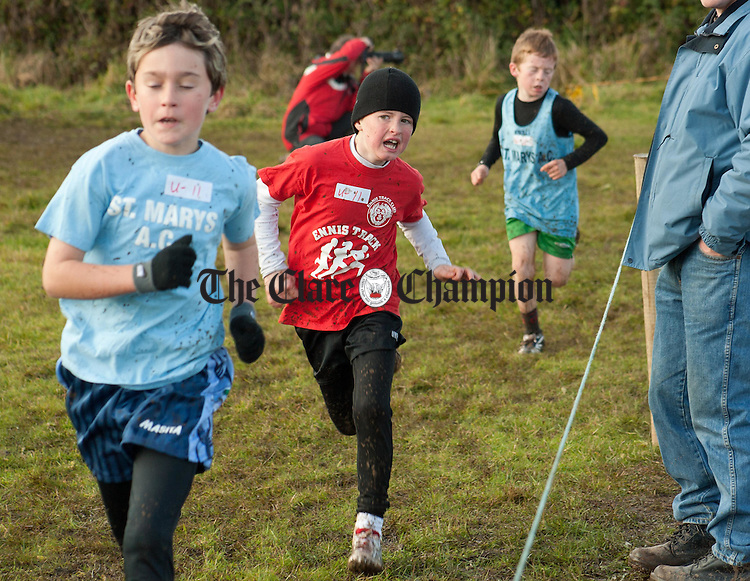 041112.Cian Lahiffe, Ennis Track, (centre) in action in the Boys U11 at Kilnaboy Cross Country on Sunday.