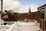Family Soak, A family soaks in the hot tub at a pool in Flúðir, a small Icelandic town of around 400 people.