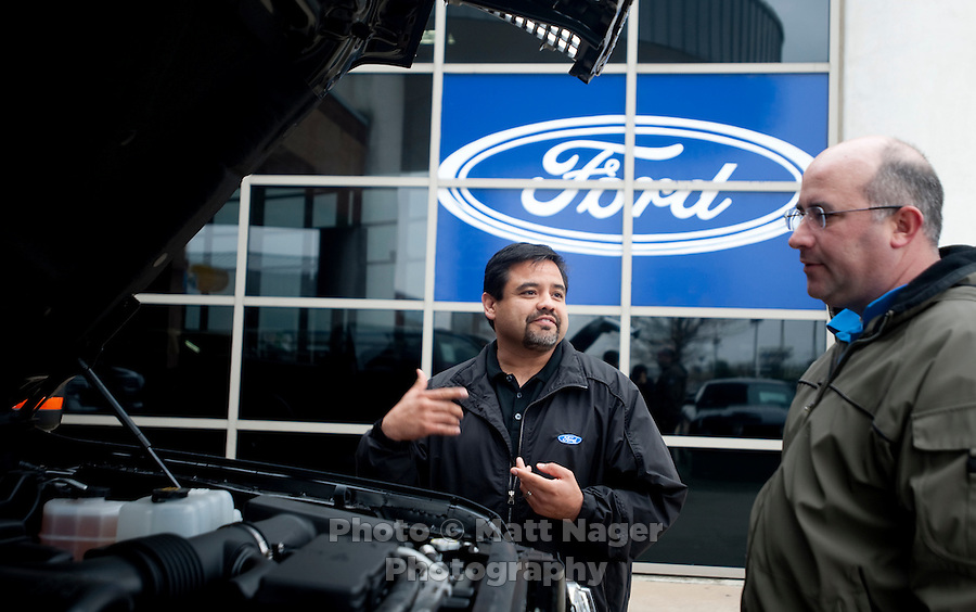 Ford truck Sales Consultant Eli Martinez (cq, left) talks with Chris Bailey (cq) about a new Ford F150 truck at Bankston Ford in Frisco, Texas, Thursday, Jan., 28, 2009. Ford reported gains in earnings for the first time in four years...PHOTOS/ Matt Nager