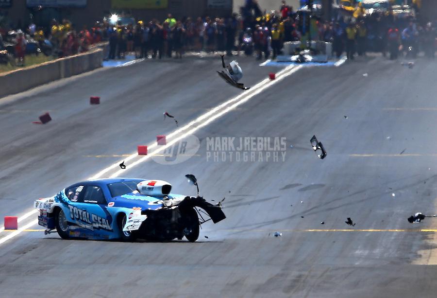 Jul. 21, 2013; Morrison, CO, USA: NHRA pro stock driver Matt Hartford crashes during the Mile High Nationals at Bandimere Speedway. Hartford was uninjured. Mandatory Credit: Mark J. Rebilas-