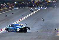 Jul. 21, 2013; Morrison, CO, USA: NHRA pro stock driver Matt Hartford crashes during the Mile High Nationals at Bandimere Speedway. Hartford was uninjured. Mandatory Credit: Mark J. Rebilas-