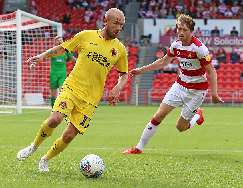 Fleetwood Town's Paddy Madden gets away from Doncaster Rovers' Tom Anderson<br /> <br /> Photographer David Shipman/CameraSport<br /> <br /> The EFL Sky Bet League One - Doncaster Rovers v Fleetwood Town - Saturday 17th August 2019  - Keepmoat Stadium - Doncaster<br /> <br /> World Copyright © 2019 CameraSport. All rights reserved. 43 Linden Ave. Countesthorpe. Leicester. England. LE8 5PG - Tel: +44 (0) 116 277 4147 - admin@camerasport.com - www.camerasport.com