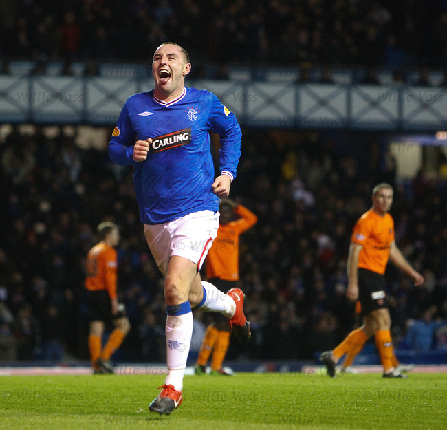 Kris Boyd scores his fifth and Rangers sixth goal and celebrates