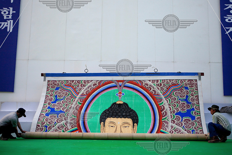 A giant picture of the Buddha is unrolled in preparation for celebrations of Buddha's birthday at Bulguksa temple close to the city of Gyeongju. Bulguksa is a head temple of the Jogye Order of Korean Buddhism.