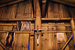 Christian shrines decorate the interior of a traditional bamboo home near Bajawa, Flores.